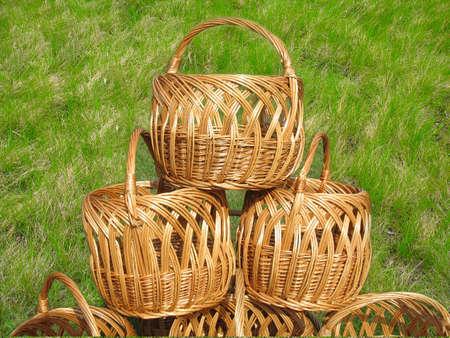 three wicker wooden baskets over green grass background photo
