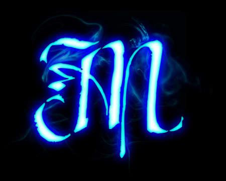 ardent: Blue fiamma magica font su sfondo nero. Lettera M