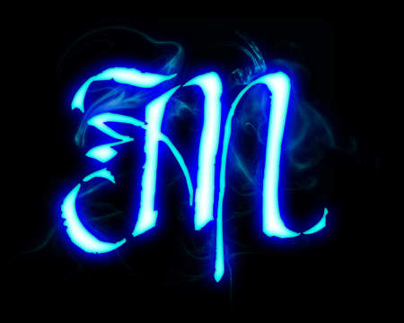 Blue flame magic font over black background. Letter M photo