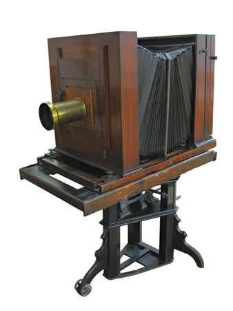ancient wooden photo camera isolated over white background photo