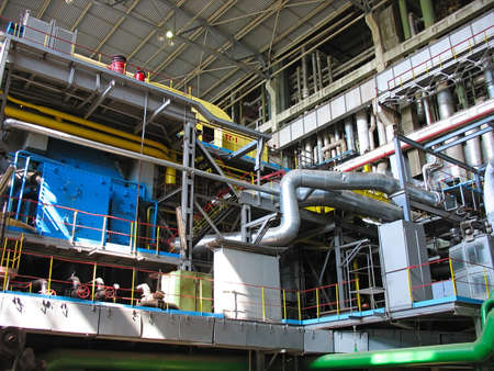 Machinery, tubes and steam turbine at a power plant photo