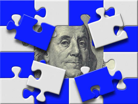 dollar banknote under missing pieses of blue and gray puzzle map photo
