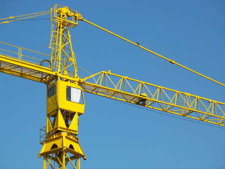 yellow building crane detail over blue sky background Stock Photo - 4835882