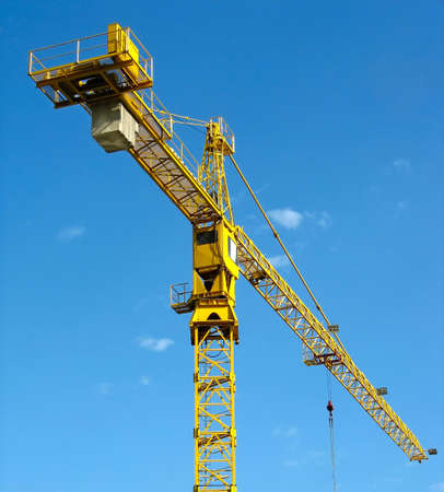 yellow building crane over blue sky background Stock Photo - 4835884