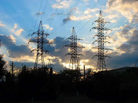 Electric Power Transmission Lines and cloudy sunset sky photo