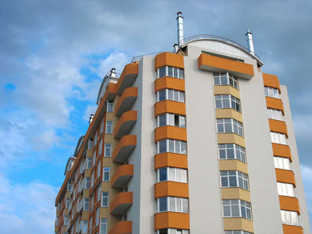 Just finished new apartment house over cloudy sky background photo