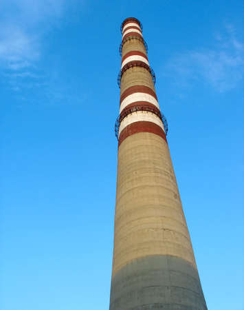Industrial chimney with white and red lines over blue sky Stock Photo - 5083788