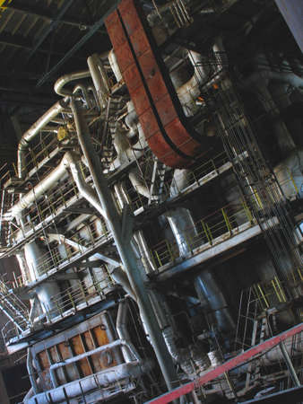 steam turbines, machinery, pipes, tubes at a power plant, night scene photo