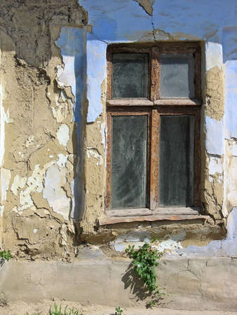 Vintage window, old brown and blue wall, abandoned house concept photo