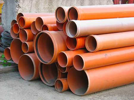 Abstract close up of a stack of orange plastic pipes on construction Stock Photo - 5327679