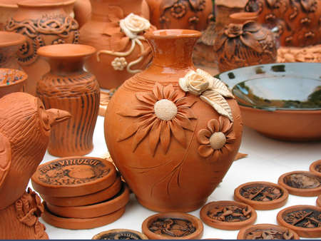 Handmade clay pots In a workshop from Europe photo