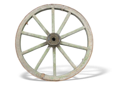 Antique Cart Wheel made of wood and iron-lined, isolated over white background photo