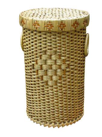 Wickerwork wood basket isolated over white background photo