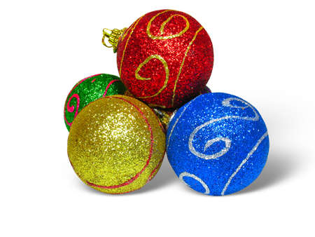 Close up shot of color Christmas balls over white background photo