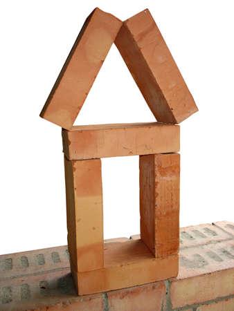 Brick arranged as a house concept over a wall Stock Photo - 7487836