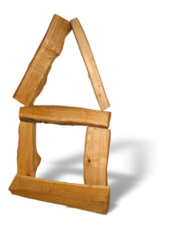 Wood logs arranged as a house concept with shadow isolated photo