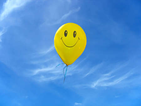Smile yellow balloon over blue sky with clouds Stock Photo - 8108456