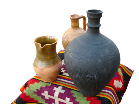 antique clay pottery jug and bowl over old handmade carpet Stock Photo - 8163413