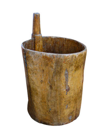 ancient wooden mortar and pestle isolated over white background photo