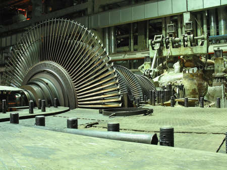 plant science: Power generator steam turbine during repair, machinery, pipes, tubes at a power plant, night scene