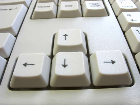 four arrow keys on a white computer keyboard Stock Photo - 9102838