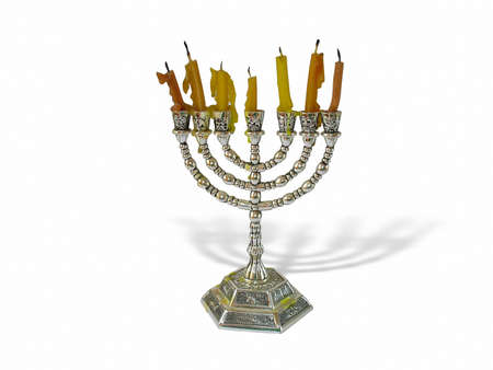 hanukkah candles in a menorah over white background photo