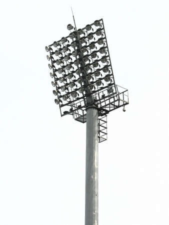 staging: Big spotlights lighting tower at an sport arena stadium