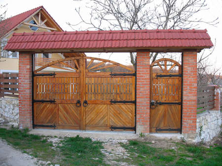 New modern wooden decorative gate in residential area photo