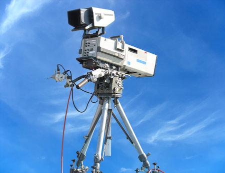 TV Professional studio digital video camera over blue sky background
