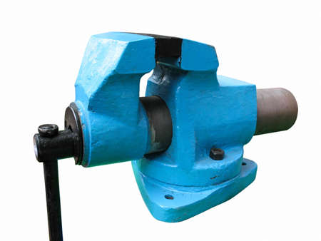 squeeze: Old blue table mechanical vise clamp on white background