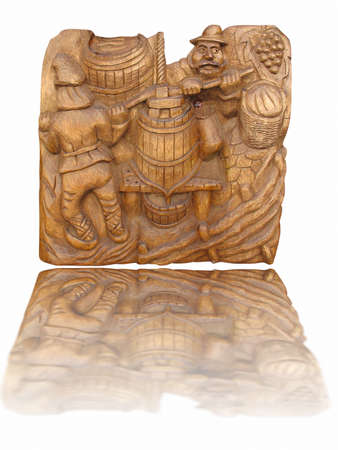 bass relief: Wine making scene on a wooden bass-relief isolated over white