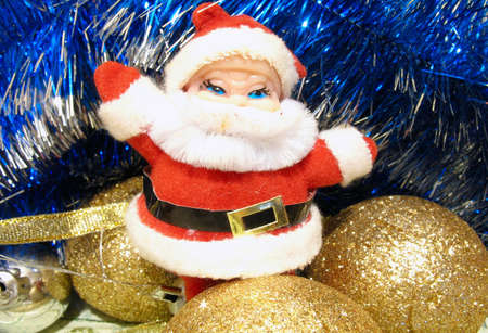 Christmas composition with Santa and golden bulbs over white Stock Photo - 11760762