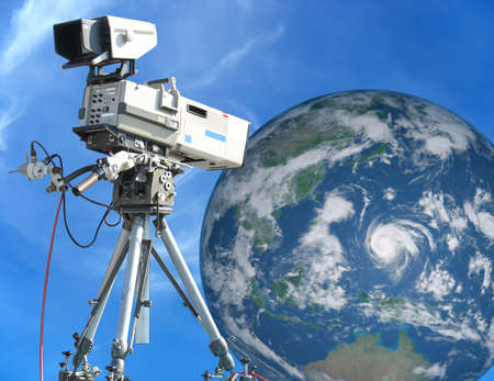 TV Professional studio digital video camera over blue sky and Earth concept