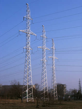 Three high-voltage power line metal tower with wires photo