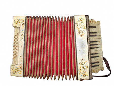 Old dirty accordion musical instrument isolated over white background photo