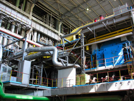 steam turbine machinery, pipes, tubes, at an power plant photo