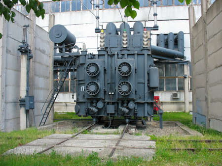 electrical wires: Huge industrial high-voltage substation power transformer at an power plant