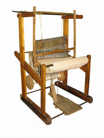 Ancient wooden loom isolated over white background Standard-Bild