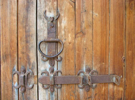 Ancient wooden door rustic metallic doorhandle detail photo