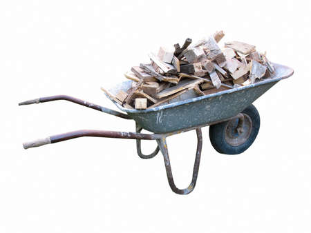An old wheelbarrow full of firewood on isolated on white background  Stock Photo - 15147486