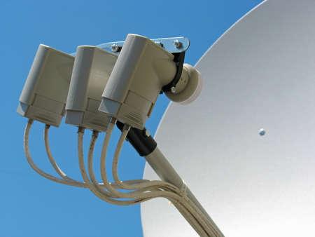 parabolic: Satellite dish antenna over blue sky background
