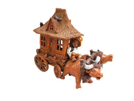 covered wagon: Clay figurine oxen and covered wagon isolated over white background