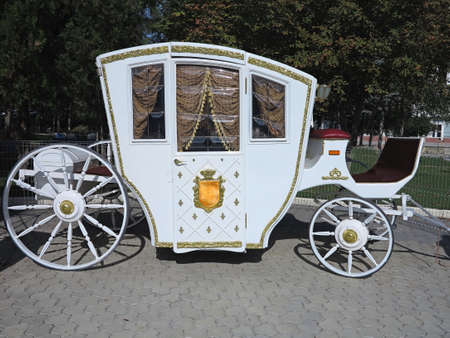 horse and carriage: Vintage white luxury royal wedding carriage in Europe Stock Photo