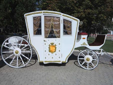 royal wedding: Vintage white luxury royal wedding carriage in Europe Stock Photo