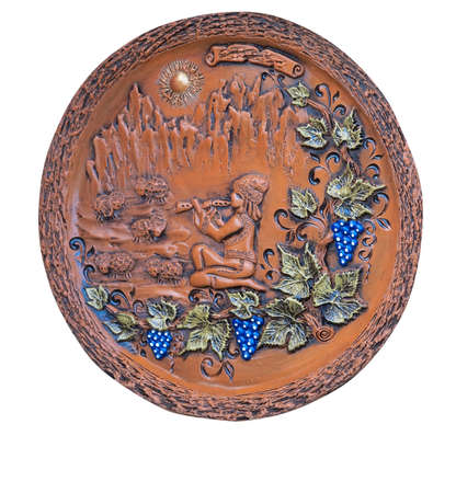ornated: Decorative ornated clay plate with grape and leafs pattern isolated