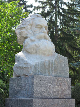 marx: Karl Marx bust stone statue in East Europe