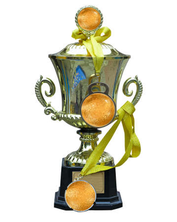 Golden trophy cup with medal and ribbon isolated on white background  photo