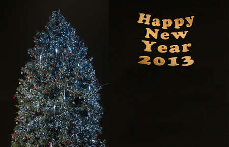 Christmas and New Year tree over black background template photo