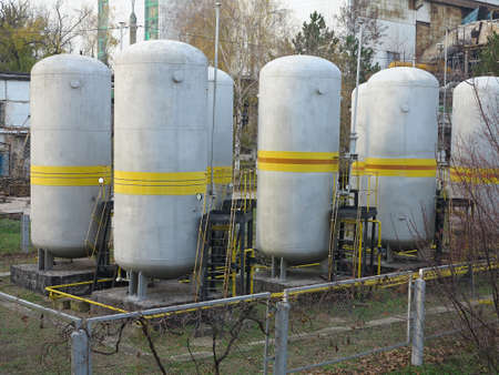 Old industrial chemical storage tanks at power plant photo