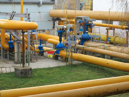 Natural gas station with yellow pipes at power plant photo